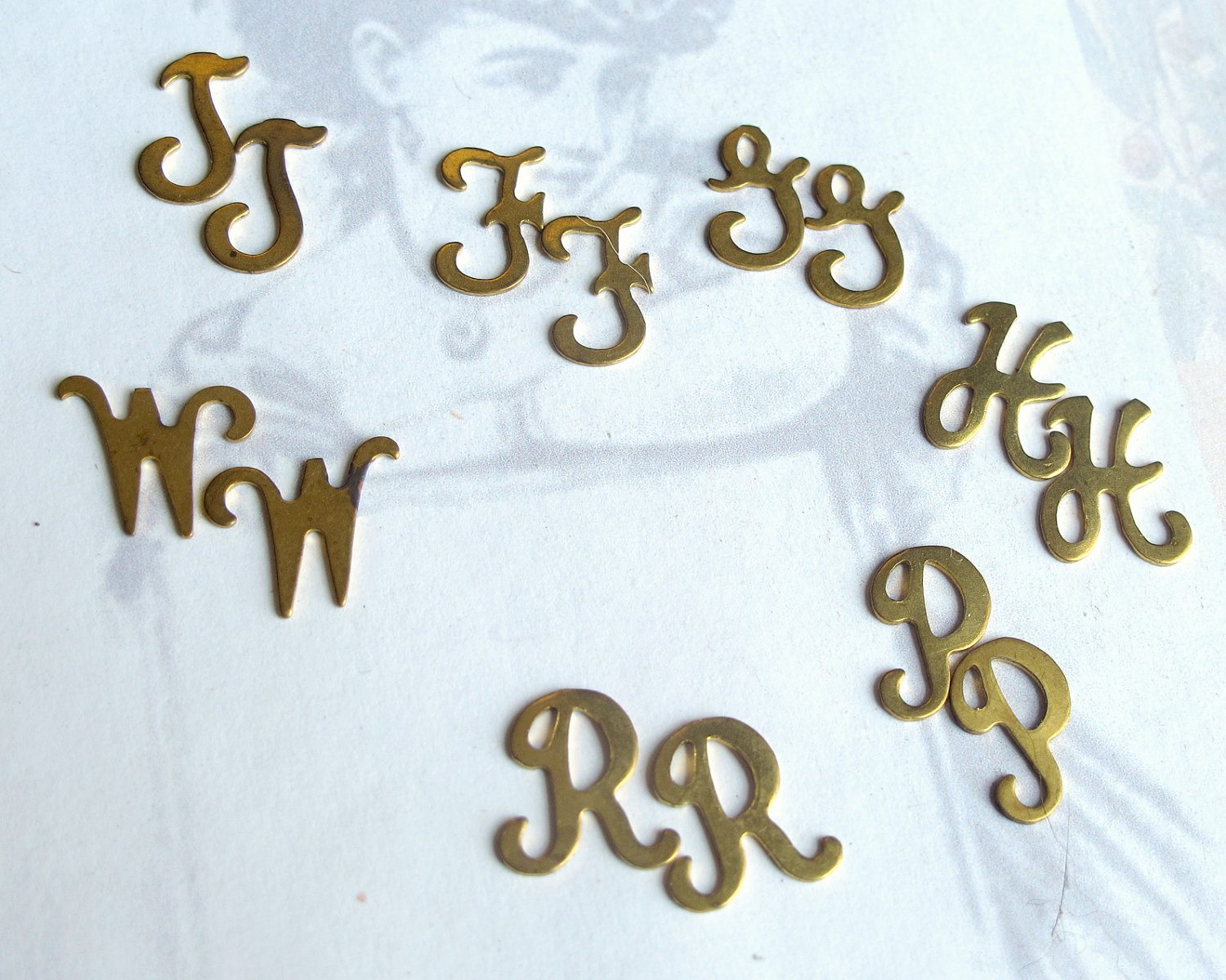 assortment of vintage raw brass script initial letter charms no