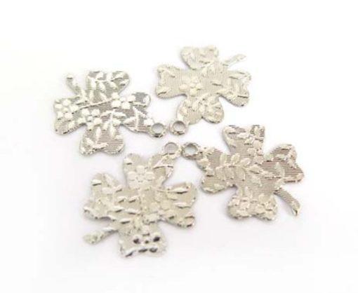 textured silver four leaf clover