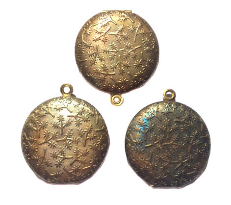 vintage antiqued brass round locket with twig texture