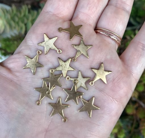 small tarnished brass engraving star charms