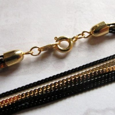 black and gold enamel multi strand necklace