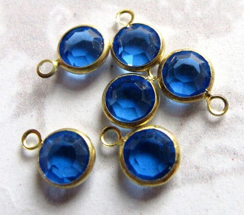 Blue Swarovski crystal in brass setting