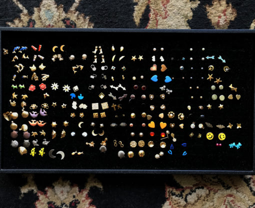 vintage stud earrings lots of colors and shapes in a tray