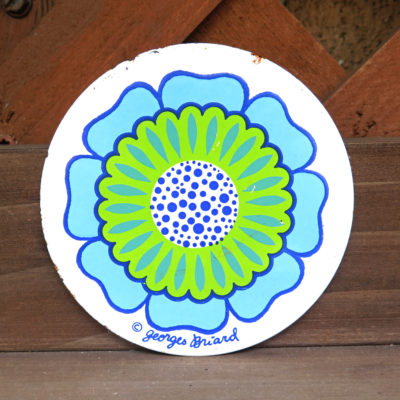 blue green and white flower circle shaped tile