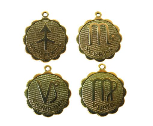 antiqued astrological pendants