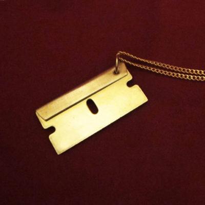 brass razor blade pendant